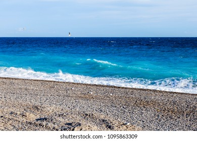 The picturesque line of a surf in the Mediterranean.