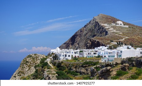 Picturesque main village (chora) of Folegandros island built on top of steep hill overlooking the Aegean sea, Cyclades, Greece