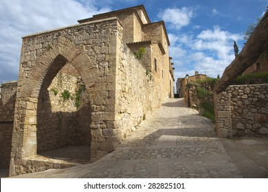 Picturesque medieval corner of a quaint hill town in tarragona, spain.