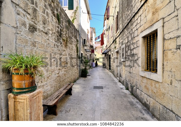 Picturesque medieval street in the old town of Trogir, Croatia