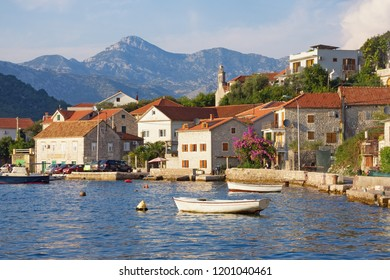Picturesque Mediterranean landscape with small seaside village. Montenegro, Adriatic Sea, Bay of Kotor, Lepetane village