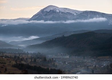 Picturesque morning above late autumn mountain countryside.  Ukraine, Carpathian Mountains, Petros top in far. Peaceful traveling, seasonal, nature and countryside beauty concept scene.