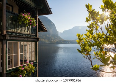 Picturesque morning scenery on Hallstatter with beautiful building with sunlit lake and mountains on background. Location: Hallstatt, Salzkammergut region, the Alps, Austria.