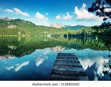 Picturesque morning view of Black Lake ( Crno Jezero ). Splendid summer scene of Durmitor Nacionalni Park, Zabljak location, Montenegro, Europe. Beauty of nature concept background.