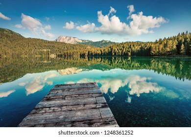 Picturesque morning view of Black Lake ( Crno Jezero ). Splendid summer scene of Durmitor Nacionalni Park, Zabljak location, Montenegro, Europe. Beauty of nature concept background.