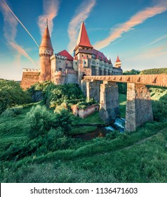 Picturesque morning view of Hunyad Castle / Corvin's Castle. Unbelievable summer sunrise in Hunedoara, Transylvania, Romania, Europe. Romanian castle landmarks. Traveling concept background.