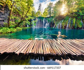 Picturesque morning view of Plitvice National Park. Colorful spring scene of green forest with pure water waterfall. Great countryside landscape of Croatia. Beauty of nature concept background.