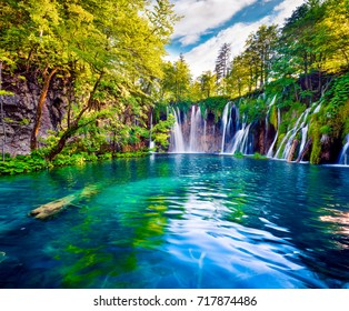 Picturesque morning view of Plitvice National Park. Colorful spring scene of green forest with pure water waterfall. Great countryside landscape of Croatia, Europe.Beauty of nature concept background.