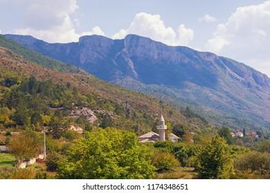 Picturesque mountain landscape, summer. Bosnia and Herzegovina, Trebinje, view of Mosque in Zupa