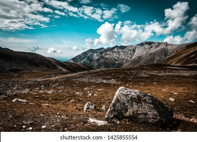 Picturesque mountain scenery with cumulus clouds. Wildlife. Hiking. Daytime. point of stumbling