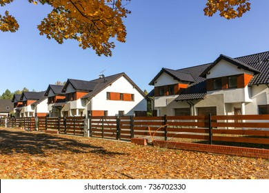 Picturesque newly built houses / suburban housing development on a beautiful autumn day