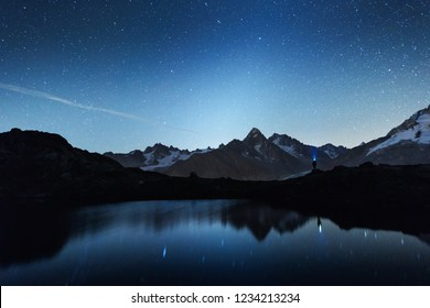 Picturesque night view of Chesery lake (Lac De Cheserys) in France Alps. Monte Bianco mountain range on background. Vallon de Berard Nature Preserve, Chamonix, Graian Alps. Landscape photography