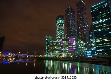 Picturesque night view of the Moscow City across the river Moscow with reflection in water, Moscow, Russia