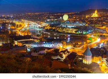 Picturesque night view of Tbilisi with bridges over Kura river, capital of Georgia - Shutterstock ID 1992250244