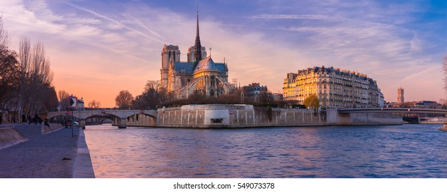 Picturesque panorama of Cathedral of Notre Dame de Paris at sunset, France