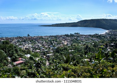 Picturesque panorama from hill of exotic city of Baracoa with lush vegetation placed on beautiful ocean shoreline, Cuba