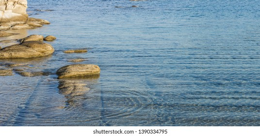 picturesque panorama scenic landscape of mountain river shoreline with stone and shallow water bottom, empty copy space for text