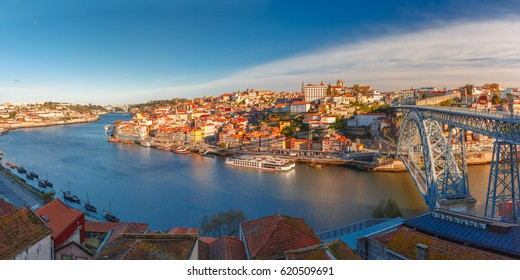 Picturesque panoramic aerial view of Old town of Porto, Ribeira and Dom Luis I or Luiz I iron bridge across Douro River in the morning, Portugal