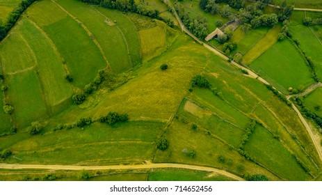 Picturesque patchwork quilt farmland aerial view over fields rural villages