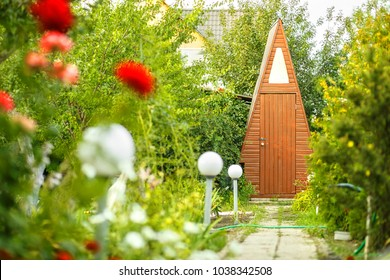 Picturesque path to the dacha toilet in the garden
