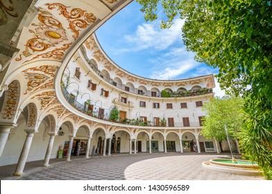 The picturesque Plaza del Cabildo in Seville, Andalusia, Spain.