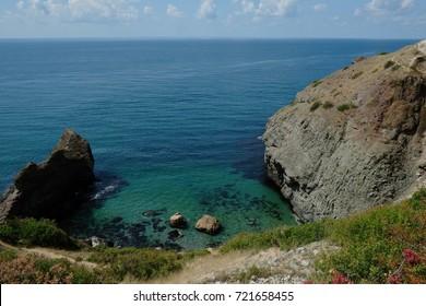 Picturesque precipitous seacoast.Beautiful beach with blue water. Crimea.