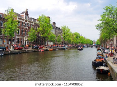 the  picturesque  prinsengracht canal, boats,  and 17th century  historic architecture in amsterdam in the netherlands