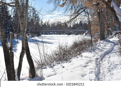Picturesque riverside trail during the winter (Calgary, Alberta, Canada)