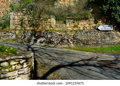 "Picturesque road in french province with ""Way to castle"" sign."