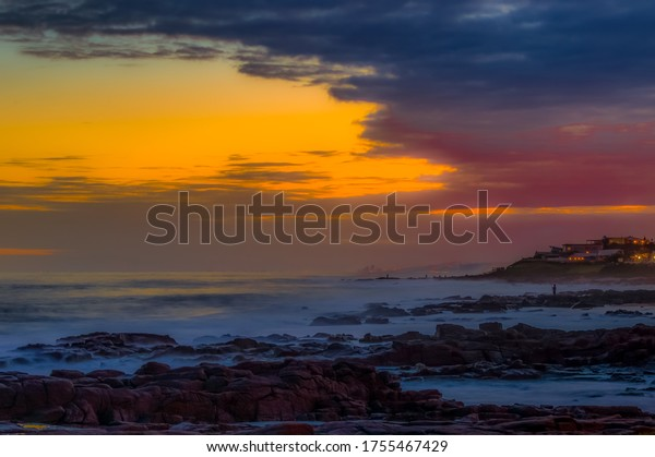 Picturesque and rocky Ballito beach landscape in north Durban , KZN South Africa