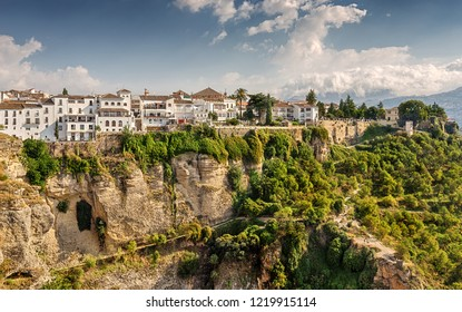 """Picturesque Ronda - one of the largest """"white towns"""" of Andalusia and the ancient towns of Spain, hanging over the steep horsetail El Tajo. Ronda. Andalusia. Spain."""