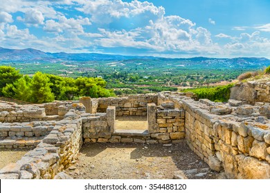 Picturesque ruins of the ancient Minoan Palace of Phaistos( Festos )and beautiful plateau Messara and mountains in the backdrop.District of Heraklion.Crete island.Greece.Europe.