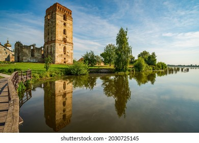 Picturesque ruins of Dominican Monastery with defensive tower reflected in water of Sluch river, Starokostiantyniv, Khmelnytskyi region, Ukraine. Popular tourist attraction - Shutterstock ID 2030725145