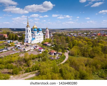 Picturesque rural landscape of small Russian town of Bolkhov with Savior Transfiguration Cathedral and Trinity Church in sunny spring day