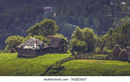 Picturesque rural scenery with remote old traditional Romanian wooden houses in Magura village, Brasov county, Romania.