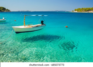 Picturesque scene of a boat in a quiet bay of Milna on Brac island, Croatia