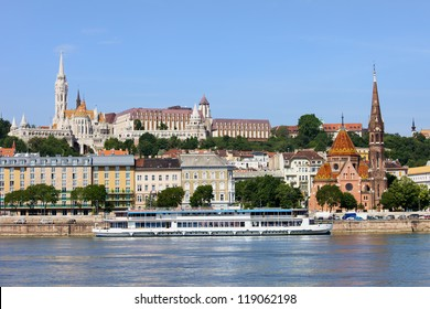 Picturesque scenery of the Budapest city in Hungary, left side on hill Matthias Church, Calvinist Church on the right by the Danube river.