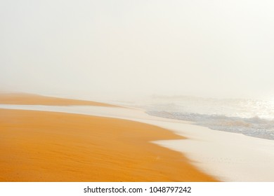 Picturesque scenery seascape of foggy misty abandoned wild beach. Art beautiful landscape of deserted cost with ocean waves. Colorful nature paysage. Desolate mediterranean costline. Fairy tale view