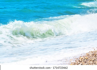 Picturesque sea landscape, wave, white foam. Natural waves and beach