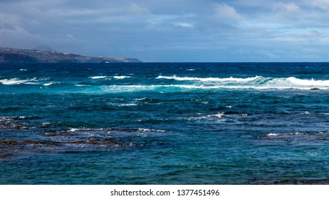 Picturesque sea waves at the line of a surf
