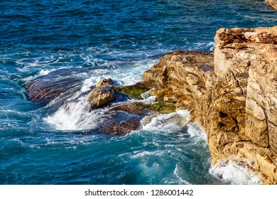 Picturesque sea waves near the rocky coast of the Mediterranean Sea