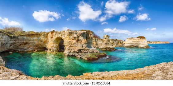 Picturesque seascape with cliffs, rocky arch at Torre Sant Andrea, Salento coast, Puglia region, Italy
