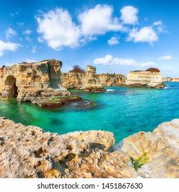 Picturesque seascape with cliffs, rocky arch at Torre Sant Andrea, Salento coast, Puglia region, Italy