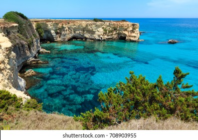 Picturesque seascape with cliffs and rocky arch, at Torre Sant Andrea, Salento sea coast, Puglia, Italy.
