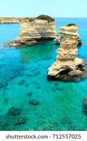 Picturesque seascape with cliffs and rocky stacks (faraglioni), at Torre Sant Andrea, Salento sea coast, Puglia, Italy.