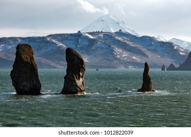 Picturesque seascape of Kamchatka: scenery rocky islands in sea with waves - Three Brothers Rocks in Avachinskaya Bay (Avacha Bay) in Pacific Ocean - popular travel destinations on Kamchatka Peninsula