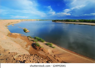 picturesque shore sloping sand bank of the river Yenisei
