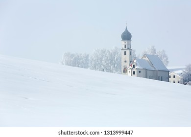Picturesque small church in Bavaria, Germany, in winter
