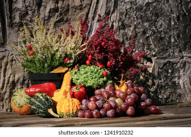 Picturesque small decoration in farm in Poland.  Vegetable with heathers composition. Autumn crops, harvest festival at the end of summer. Halloween.