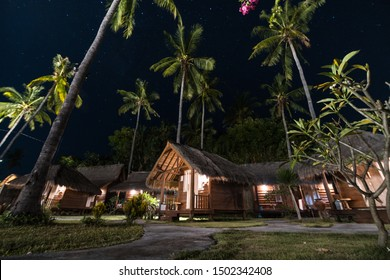 Picturesque small indonesian houses with straw roofs and palms under wonderful south sky with million bright stars. GILI AIR Air island